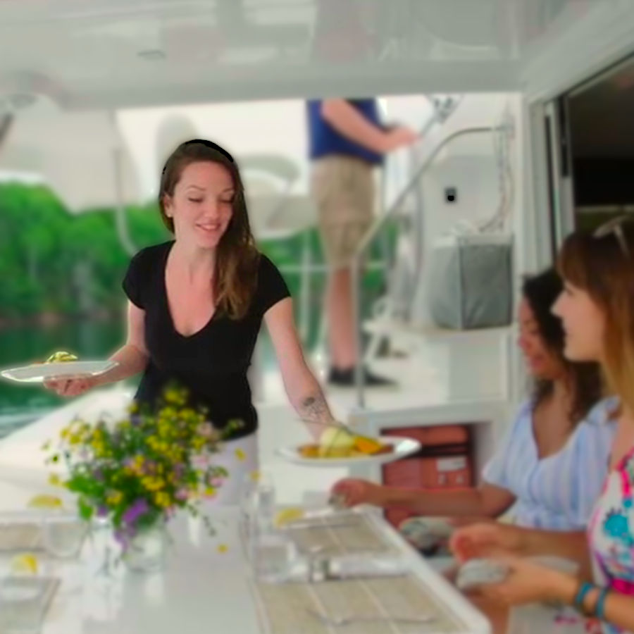 Tracy Jamieson, Host and First Mate, serving dinner aboard the Cape Bretoner 1